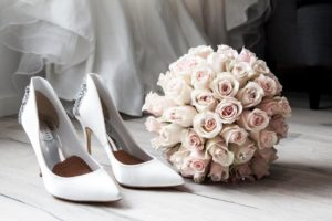 bouquet of flowers and bridal shoes
