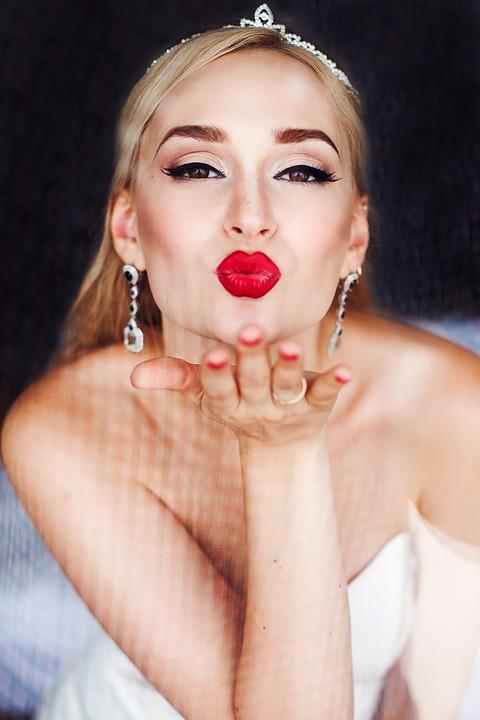 Glowing Skin bride blowing kiss
